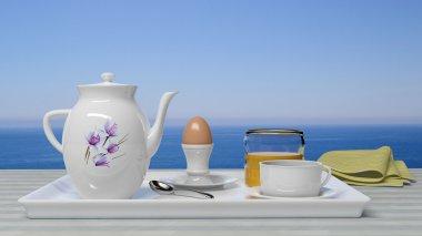 Breakfast set in front of a beautiful seascape
