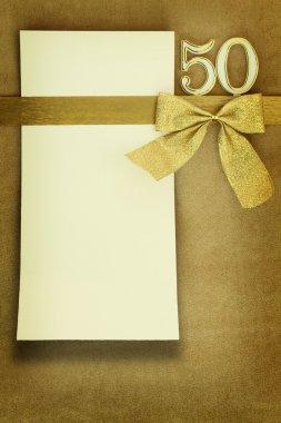 Anniversary card on golden background