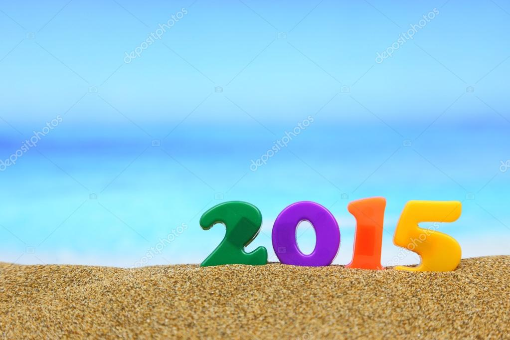Multicolored new year 2015 on the beach