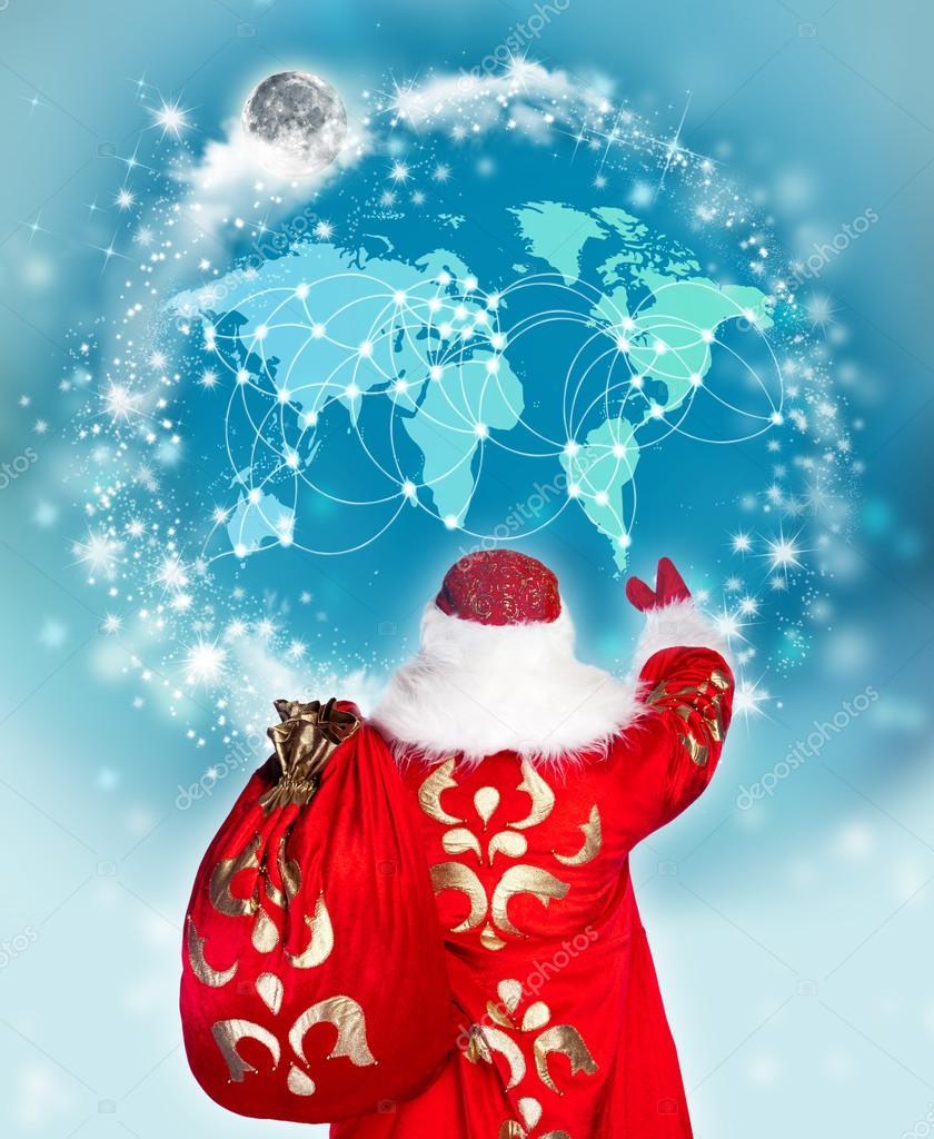 Santa Claus preparing for Christmas. He is looking at digital wo
