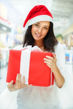 Portrait of young pretty woman wearing Santa Claus helper hat st