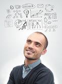 Mladý obchodní muž vzhlédl a plánování. grafický nákres styl