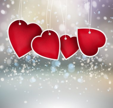 Valentine heart hanging labels on shining background