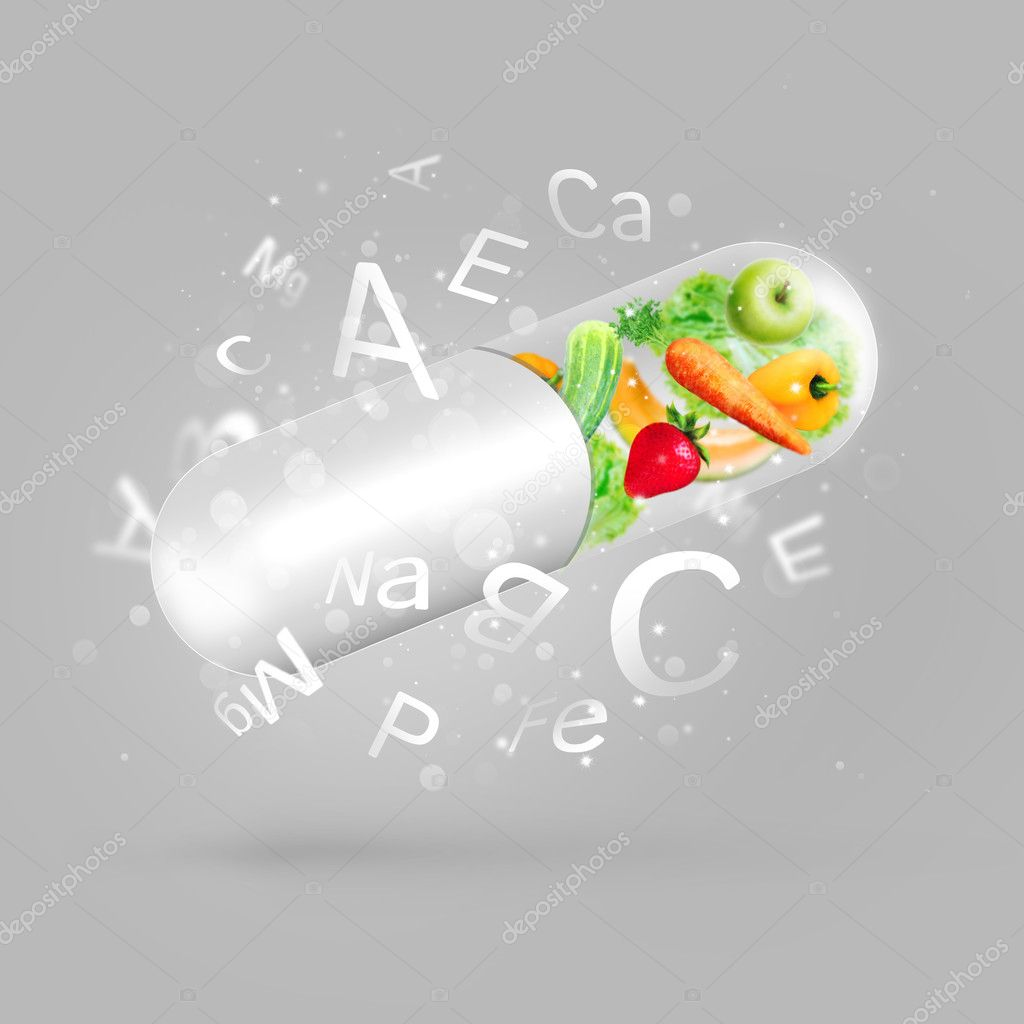 Different fruit and vegetables in capsule - healthy diet or natu
