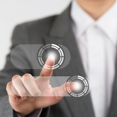 Business woman pushing virtual button on touch screen