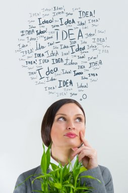Idea concept. Young business woman with idea signs overhead