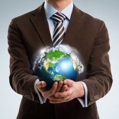 Businessman keeps the world in his hands