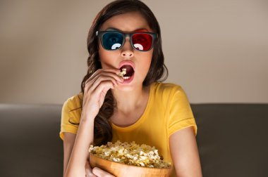 Young woman with popcorn and 3d glasses watching movie at home stock vector