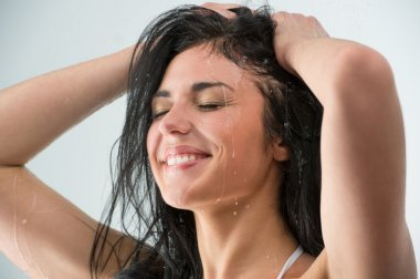 Woman showering with happy smile and water splashing