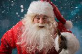 Photo Santa Claus running outdoors at North Pole