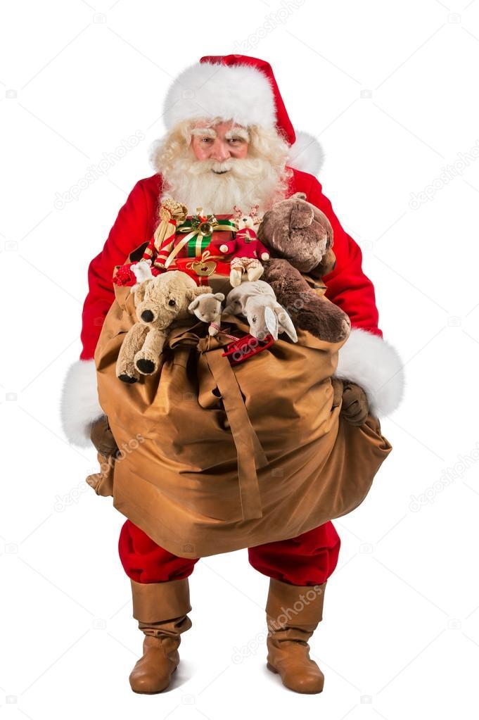 full length of real santa claus carrying big bag full of gifts stock photo - Santa Claus Gifts