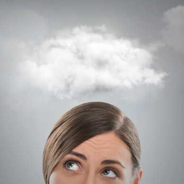 Close up of young woman looking up for thought bubble above her head with copy space