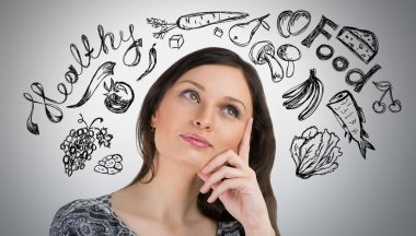 Young pretty woman thinking of healthy food closeup face portrait