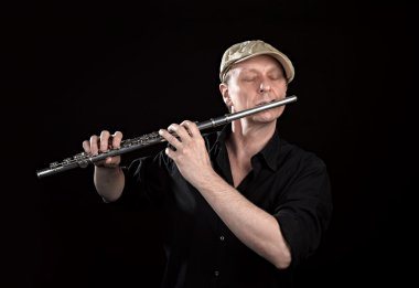 Portrait of a man playing old silver transverse flute