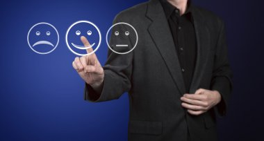 Businessman touching screen with customer service evaluation for