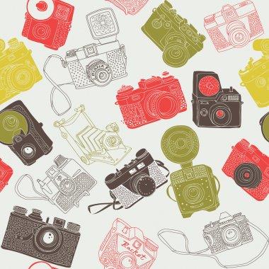 Vintage photo cameras. seamless pattern