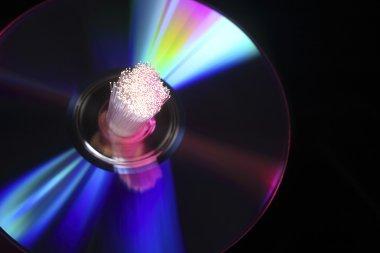 Close up of bundle of fiber optic through cd rom stock vector
