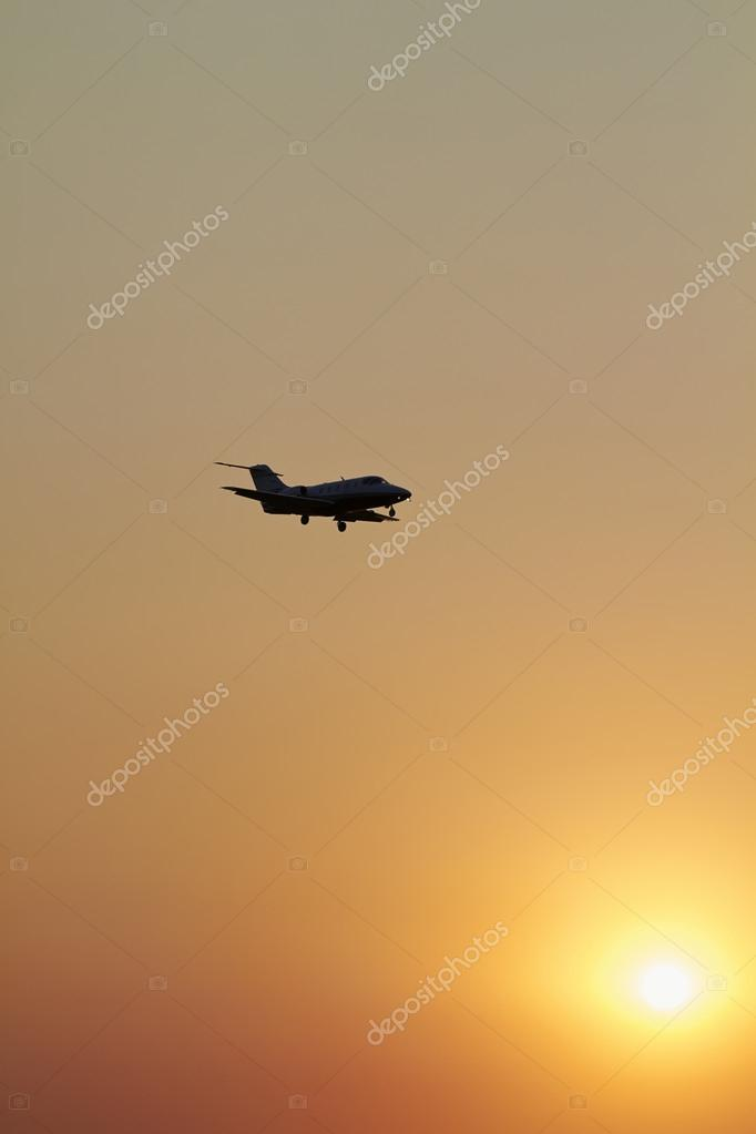 Executive jet flying in the sky at sunset — Stock Photo