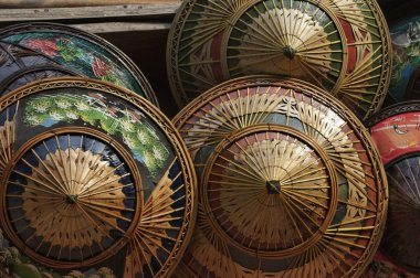 Hand painted Thai hats for sale at the Floating Market