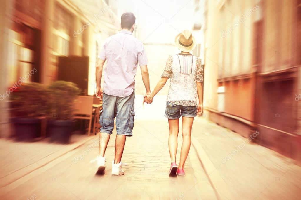 Young couple strolling about the city