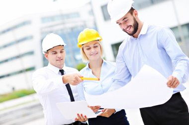 Group of young architects on site