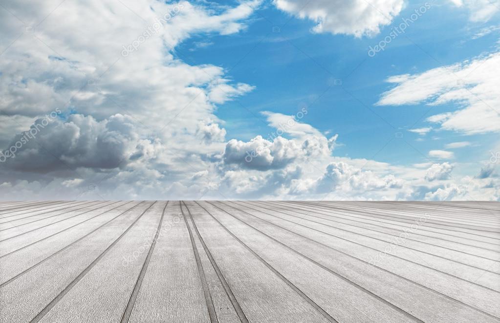 Wood floor and blue sky