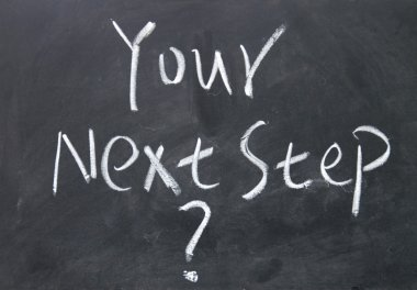 your next step sign written with chalk on blackboard