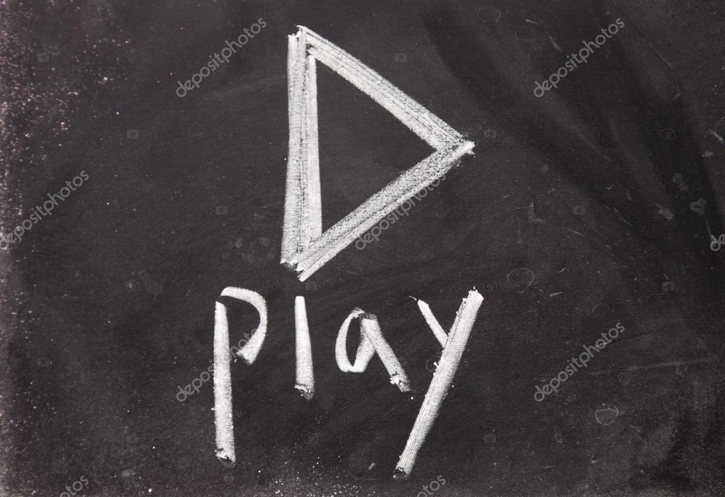 play sign drawn with chalk on blackboard