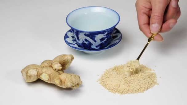 Ginger, root and preparing a tea with instant tea powder