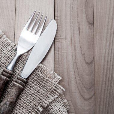 Vintage silverware on wooden background
