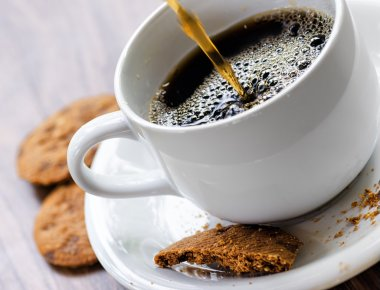 Coffee and oatmeal cookies on wooden table