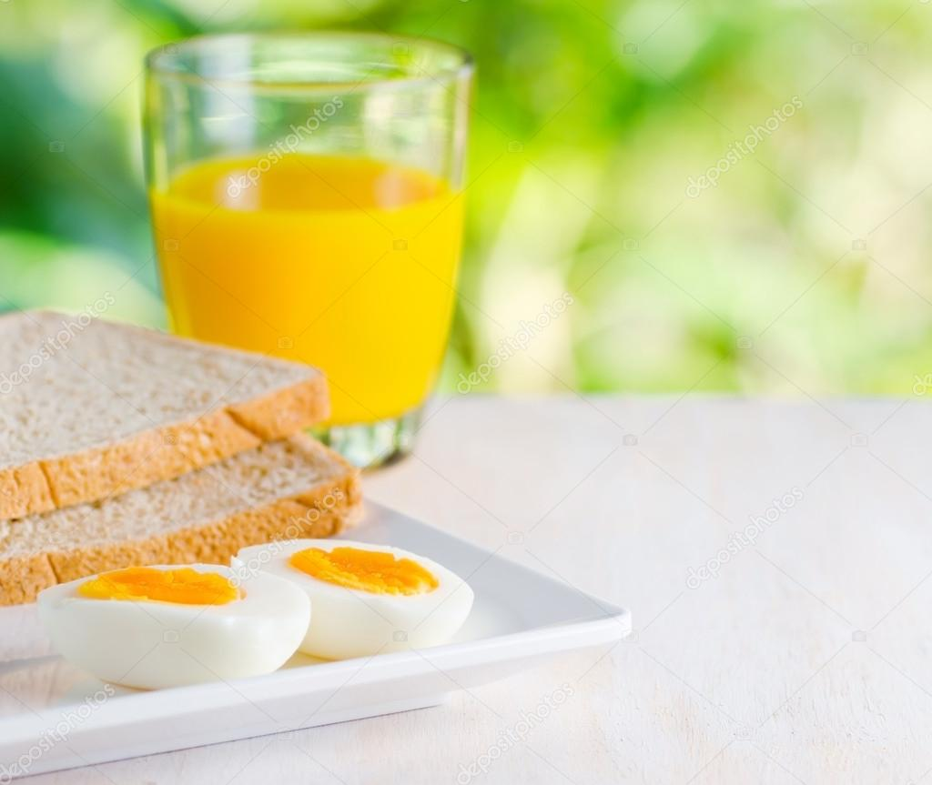 Boiled egg, toasts and orange juice.