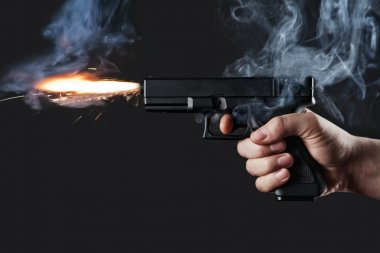 Shot from a handgun with fire and smoke stock vector