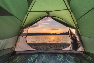 Green tent on lake coastline closeup stock vector