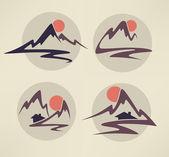 Mountain view, vysoké vrcholky a malé domy