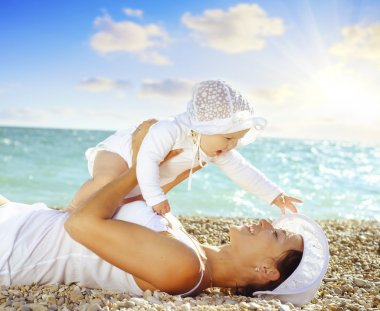 Mother with her baby on the beach