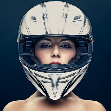 Sexy woman in helmet on dark background stock vector