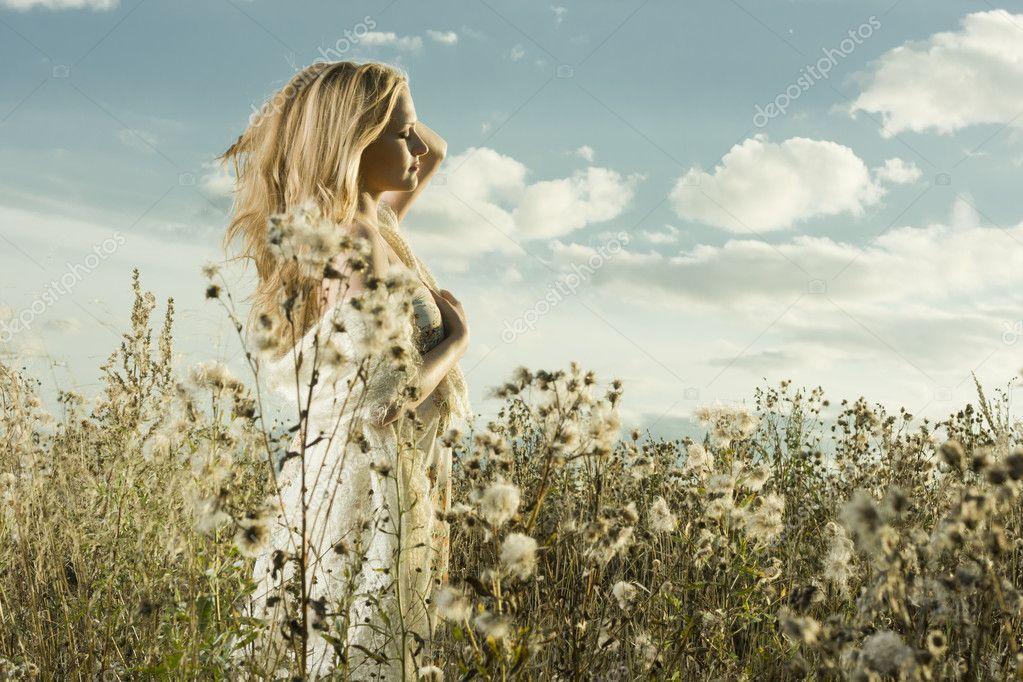 Portrait of a girl walking in field