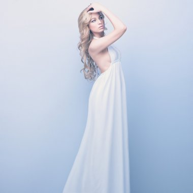 Portrait of beautifull woman standing in white dress