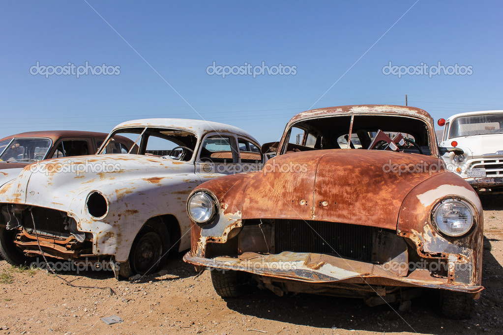 Front view of old rusty cars — Stock Photo © DigitalArtB #25254199