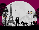 Fotografie Carriage and lovers at night in Paris