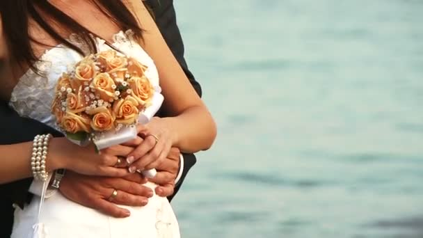 Bride and groom holding a wedding bouquet
