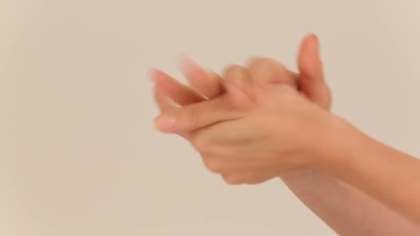 Woman using moisturizing hand cream. Close-up.