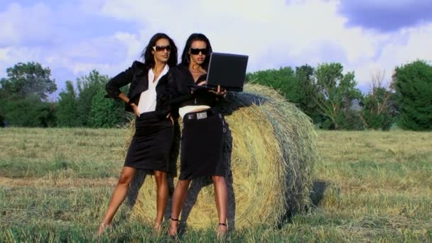 Two businesswomen in a field