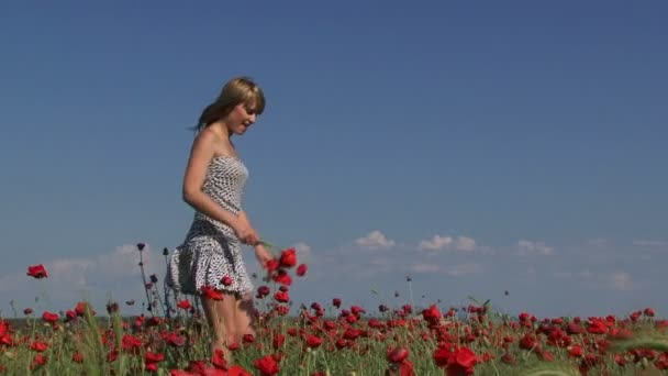 Woman with a bouquet of poppies