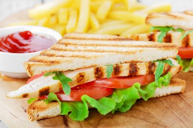 Sandwich with grilled chicken and tomatoes  french fries