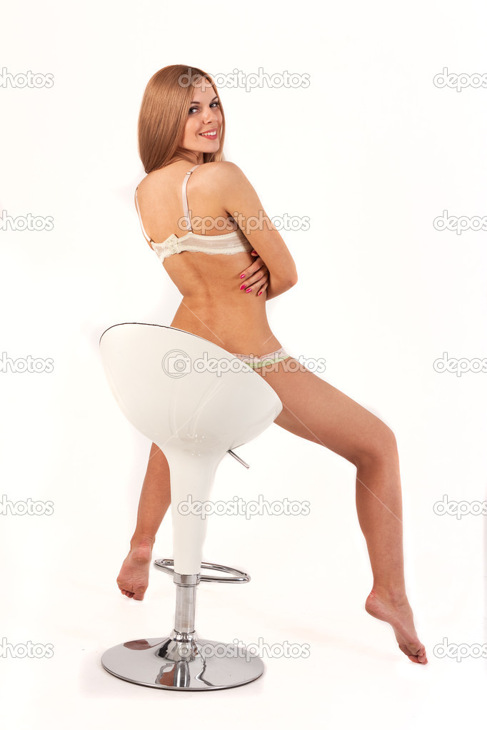 Sexy hot girl in a chair — Stock Photo © exshutter #48656141