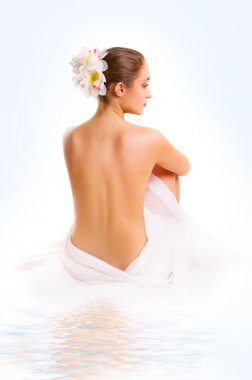 young woman, sitting with a bare back.