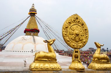 Golden statues in front of Bodhnath stupa in Kathmandu