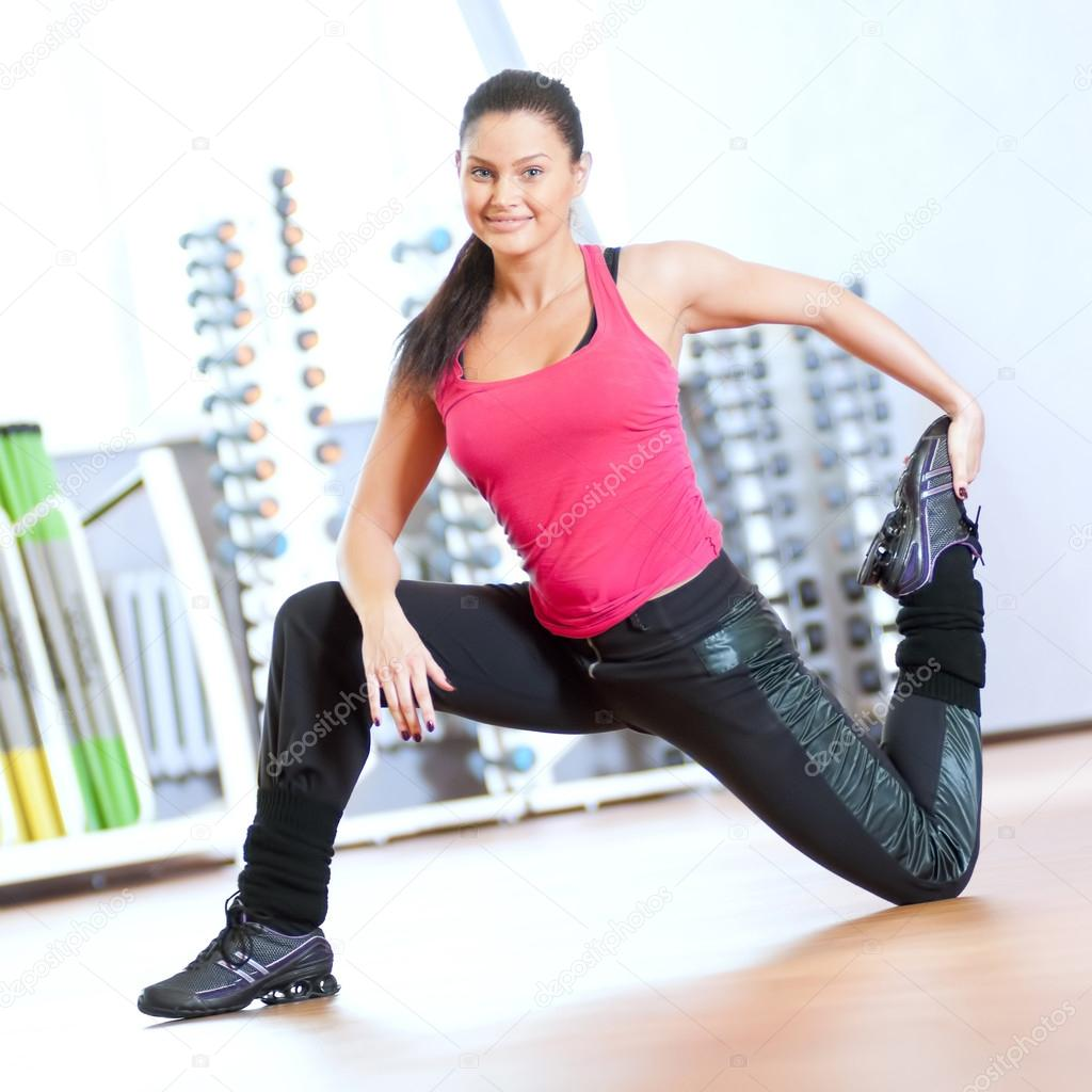 Woman Pilates Chair Exercises Fitness Stock Photo: Woman Doing Stretching Exercises At The Gym